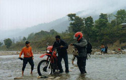 Our mechanic taking out the fallen in the river